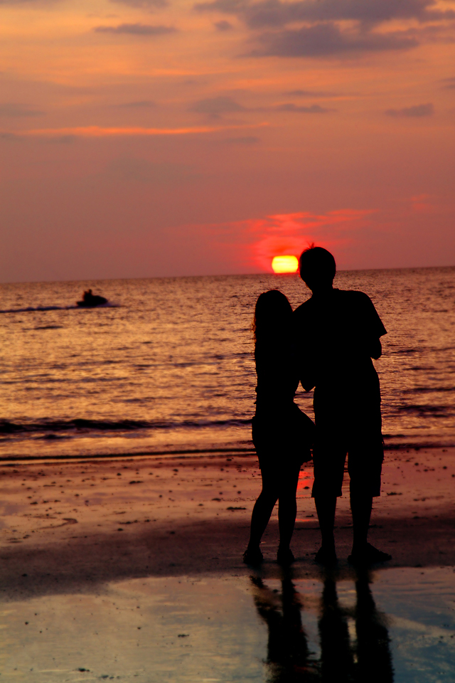 sunset loving couple