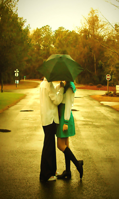 couple Kissing Under Umbrella