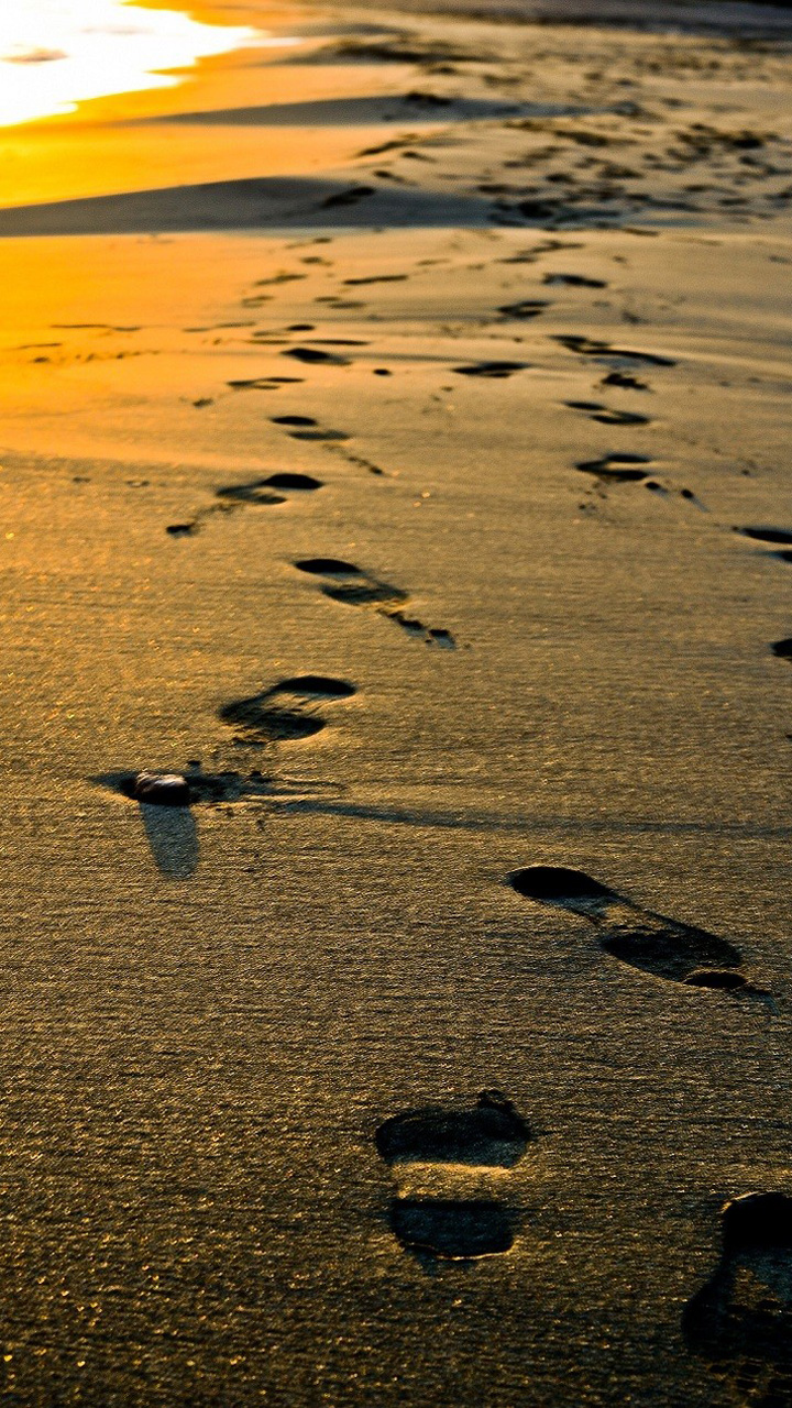 Footsteps On Beach Wallpaper