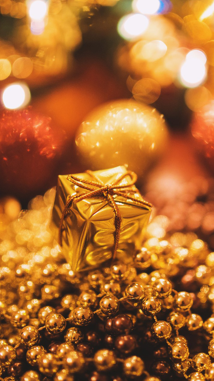 tiny gold christmas gift | mobile wallpaper | phone background