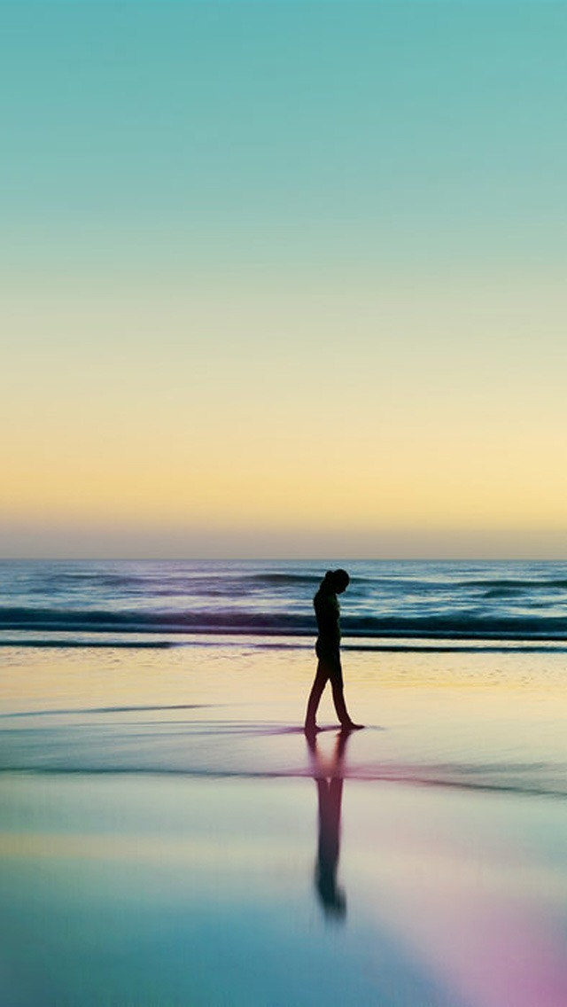 Woman Silhouetted The Beach