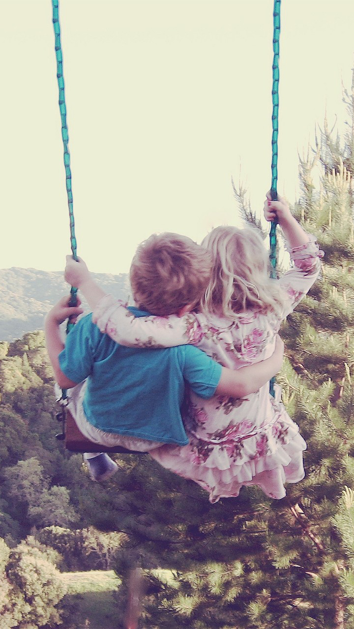 Cute Couple Swing In Forest