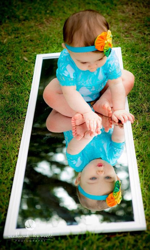 Cute Kid Playing on Mirror
